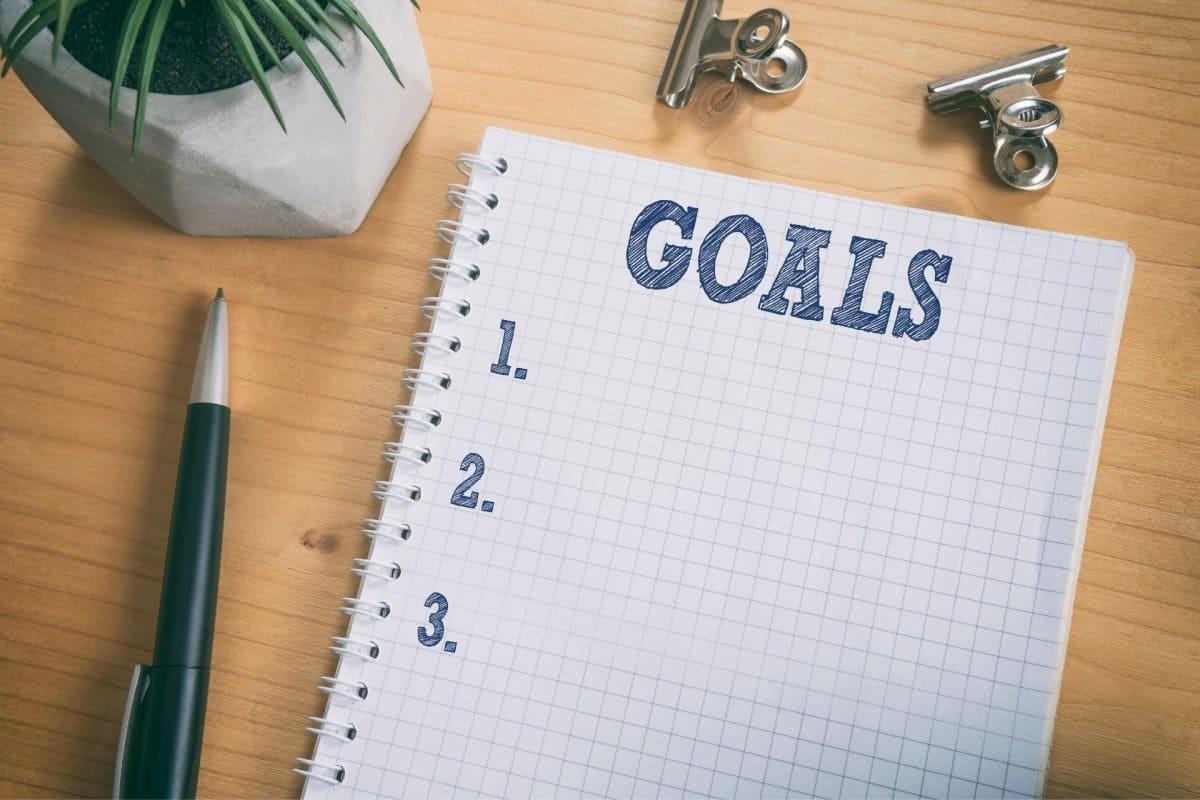 Goals written on a sheet of paper with a pen