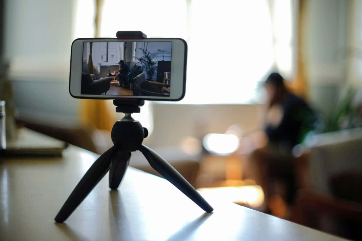 Smart Phone Sitting on a Table Recording a Person