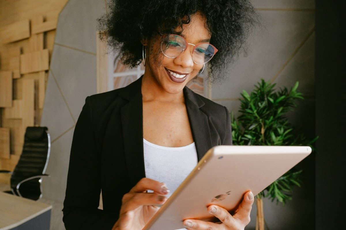 Business Woman with Glasses and Suit Holding a Tablet