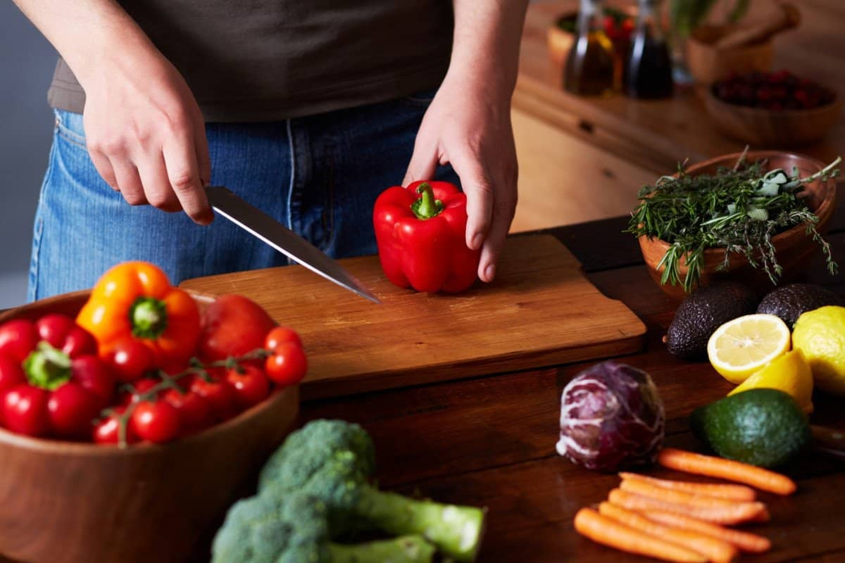 Man Cutting Vegetables with Knife for a Healthy Meal