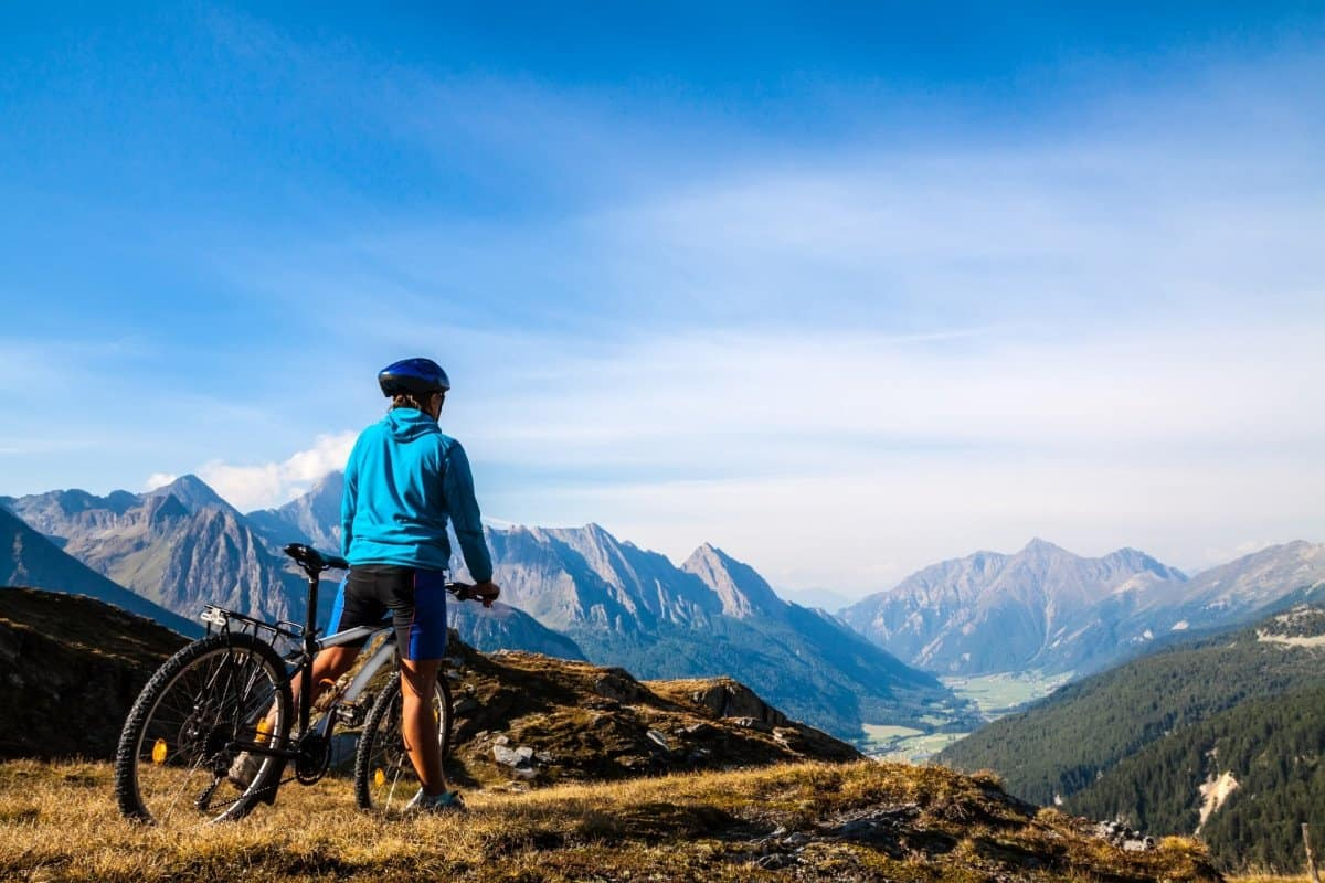 Man Mountain Biking on Top of a Mountain