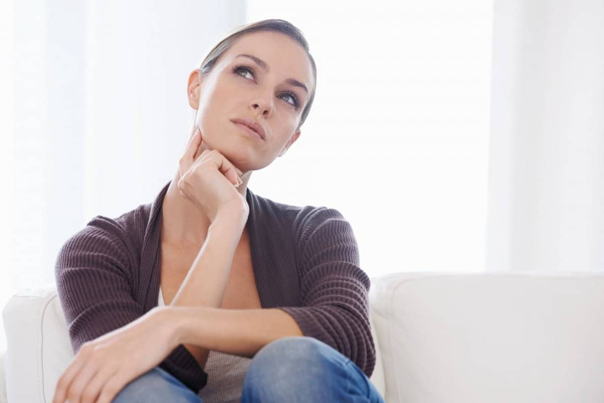 Woman in Brown Shirt Wondering What Type of Course to Create
