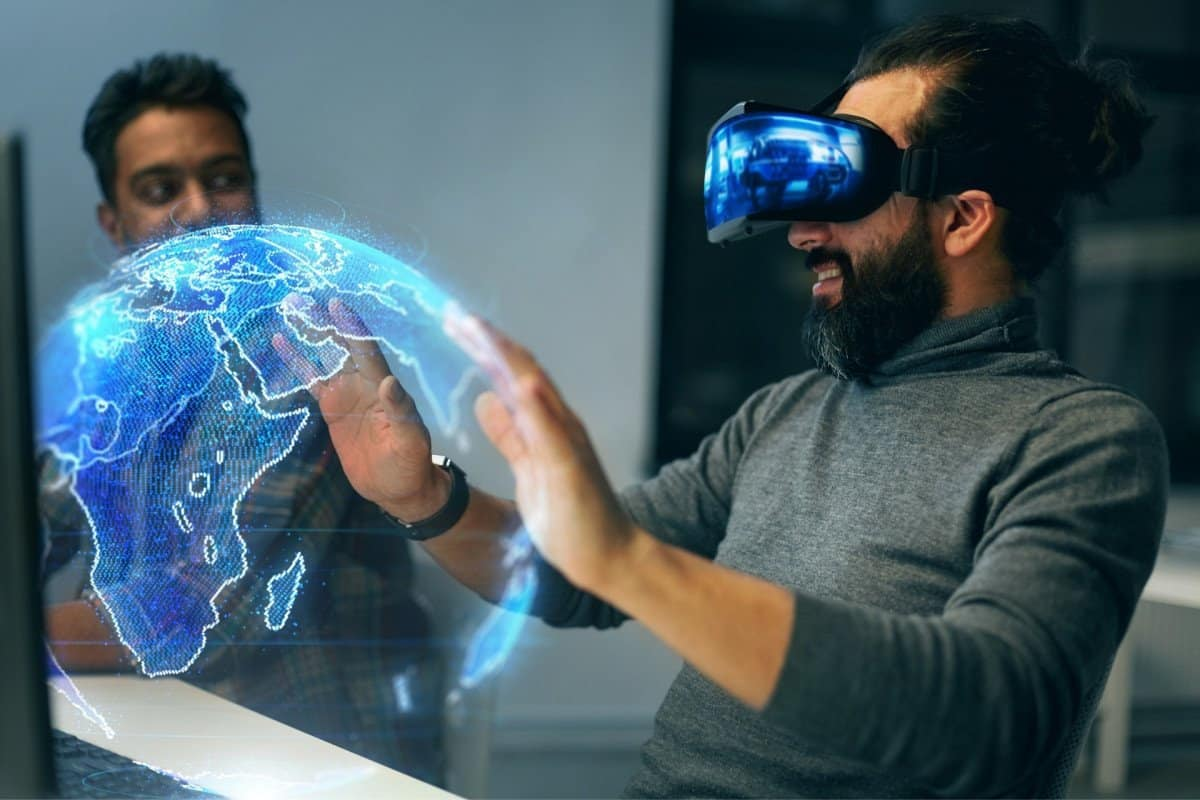 Man Touching Hologram Globe with Virtual Reality Headset On